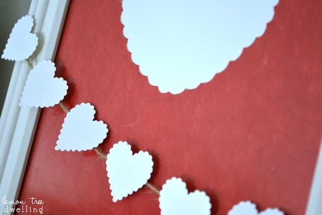 Little white hearts cut out of card stock
