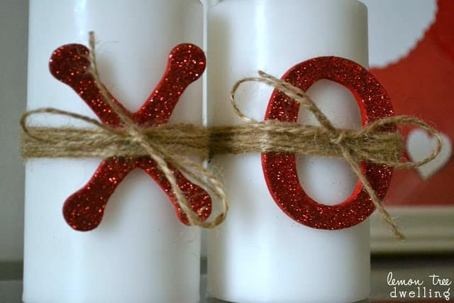 white candles decorated with x's and o's for Valentine's Day