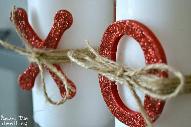 x's and o's tied with twine onto white candles
