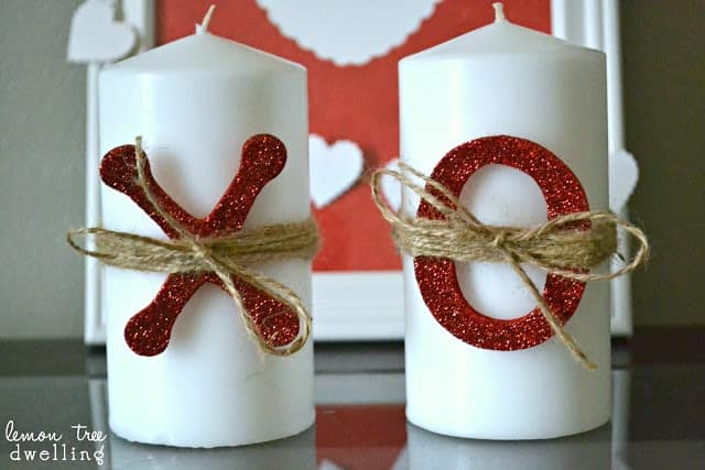 2 white valentine's day candles - one with a big X on it and one with a big O on it