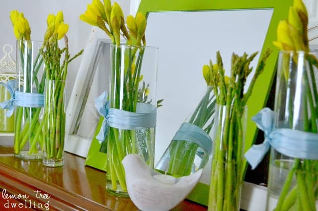 spring mantel home decor - vases of fresh flowers and spring green decor