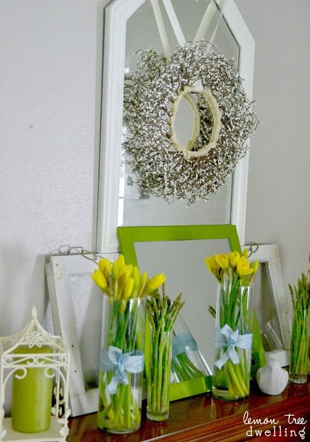 DIY home mantel decor in spring green colors with vases of fresh yellow daffodils