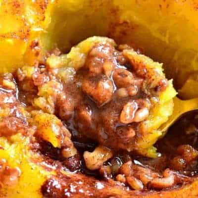 Candied Acorn Squash is baked with brown sugar, butter, cinnamon, nutmeg, and walnuts. This delectable tasty side dish perfect is just for the holidays!