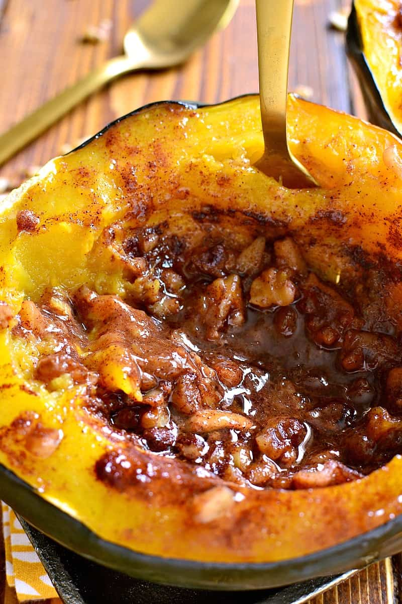 Tender Acorn Squash baked with brown sugar, butter, cinnamon, nutmeg, and walnuts. A delectable side dish....perfect for the holidays!