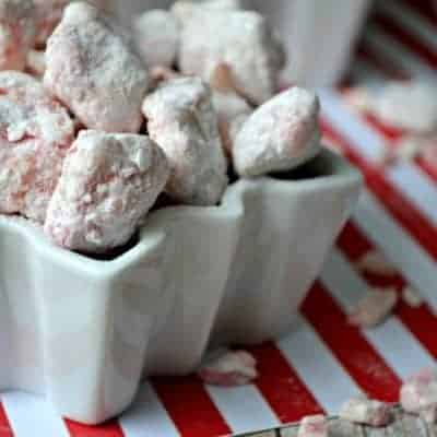 Candy Cane Muddy Buddies are a sweet and crunchy mint treat sure to please everyone over the holidays! Chocolate and Mint - It's pure peppermint perfection!
