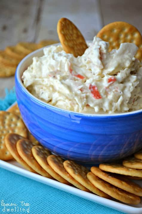 Crock Pot Crab Dip is a deliciously creamy dip made with 2 different kinds of cheese, imitation crab, and a splash of white wine. It's simple, it's delicious, and best of all.....it's made in a crock pot!