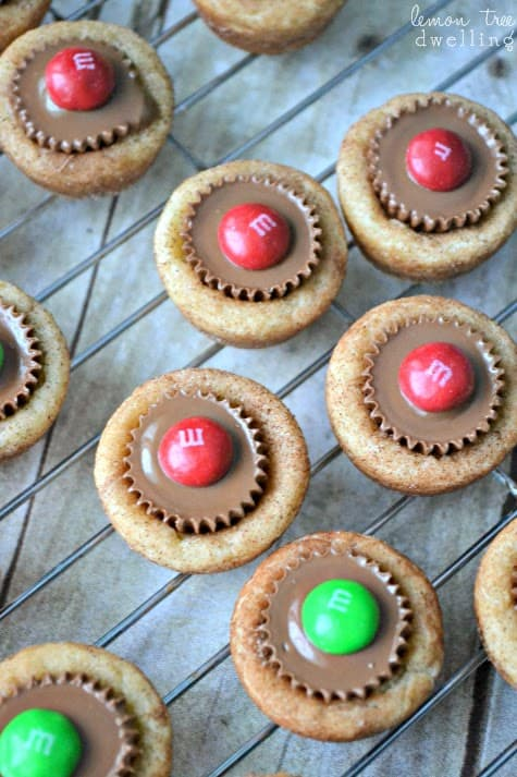 Snickerdoodle cookie cups stuffed with miniature peanut butter cups and topped with festive red & green m&m's. A fun and delicious combination....perfect for Christmas!