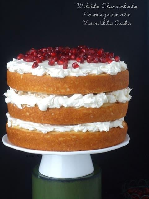 http://blahnikbaker.com/2013/12/white-chocolate-pomegranate-vanilla-cake/