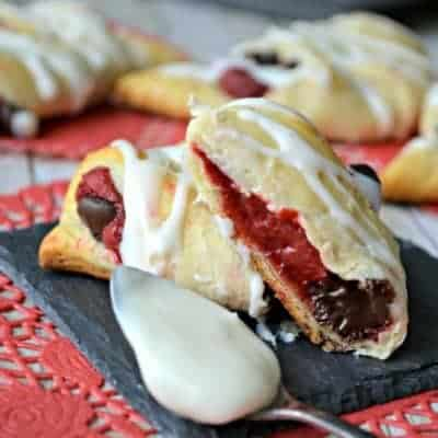 Red Velvet Cheesecake Crescent Rolls are stuffed with a creamy red velvet and dark chocolate filling.