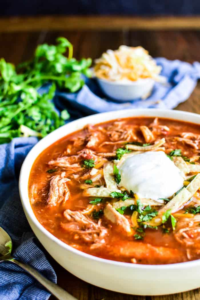 Chicken Tortilla Soup with tortilla strips, sour cream, and cilantro