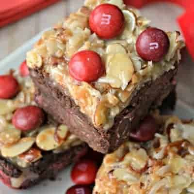 German Chocolate Cherry Bars are loaded with Cherry M&Ms and topped with a thick layer of gooey coconut almond goodness