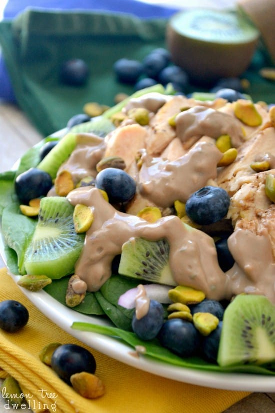 This Pistachio Spinach Salad is filled with delicious fresh ingredients and marinated chicken breast, perfect with a creamy balsamic dressing.