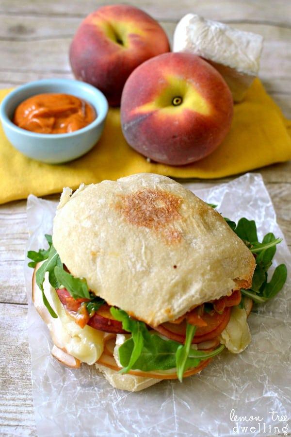 Turkey-Brie Sandwich with peaches, arugula, & spicy mayo