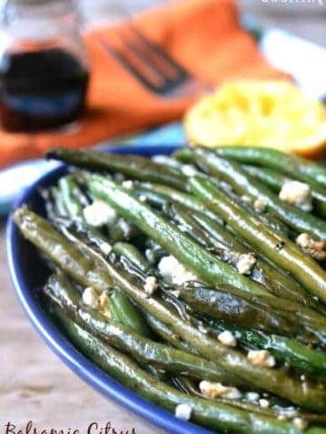 Balsamic Citrus Green Beans are roasted with balsamic vinegar, orange juice, and goat cheese. This quick and easy side dish are sure to please everyone.