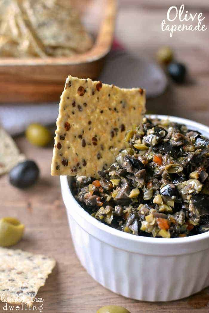 Olive Tapenade made with black and green olives is packed with flavor and perfect for dipping! This easy recipe comes together in minutes and is the BEST olive tapenade ever!