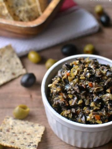 Olive Tapenade made with black and green olives is packed with flavor and perfect for dipping! This easy recipe comes together in minutes. Best tapenade ever!