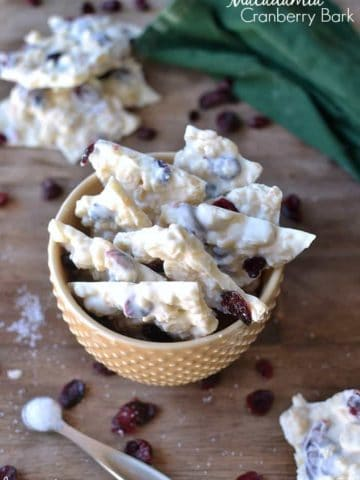 White Chocolate Macadamia Cranberry Bark makes a delicious 5 minute holiday treat. A classic combination in a crispy bark, finished off with a touch of sea salt. So delicious!