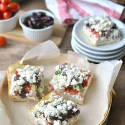 Greek Veggie Pizza Squares with crescent roll crust, tzatziki cream cheese, fresh Greek vegetables, and crumbled feta cheese!