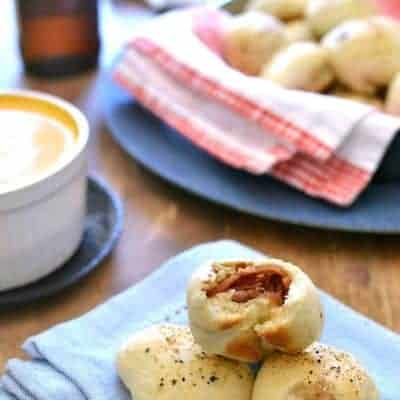 Bacon Bombs with Beer Cheese Dipping Sauce will be your new favorite appetizer! These bite sized rolls with bacon are the perfect combination for game day!