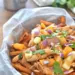 BBQ Chicken Sweet Potato Poutine is a delicious twist on a classic Canadian dish. Made with crispy sweet potato fries, this easy dish is perfect for snack time, dinnertime, or game time!