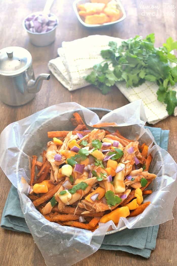 BBQ Chicken Sweet Potato Poutine is a delicious twist on a classic Canadian dish. Made with crispy sweet potato fries, this easy dish is perfect for snack time, dinnertime, or game time!#SpringIntoFlavor #CollectiveBias