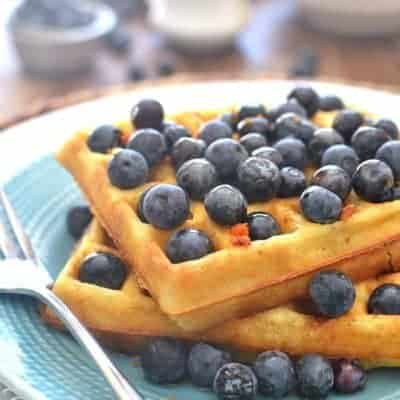 Blueberry Orange Waffles are light & fluffy and easy to make. These delicious brunch waffles are perfect with warm vanilla syrup. A quick and easy breakfast!