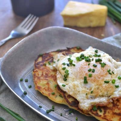Savory Irish Potato Pancakes, loaded with Kerrygold Skellig cheese, fresh chives, and minced garlic for a delicious meal