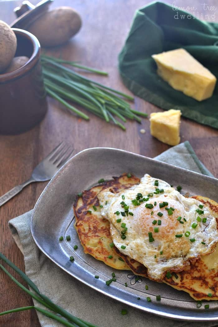 Cheesy Irish Potato Pancakes. Loaded with Kerrygold Skellig cheese and fresh chives and served with an egg. Delicious for breakfast, lunch, or dinner! #KGgrassfed