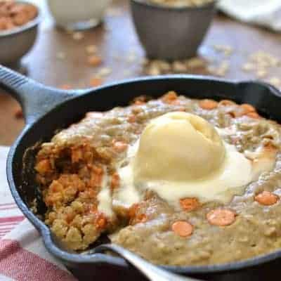 An Oatmeal Scotchie Pizookie is a deep dish decadent dessert everyone can enjoy! This lightened up version is a perfect hot dish for those cold winter nights, reminiscent of a warm oatmeal cookie!