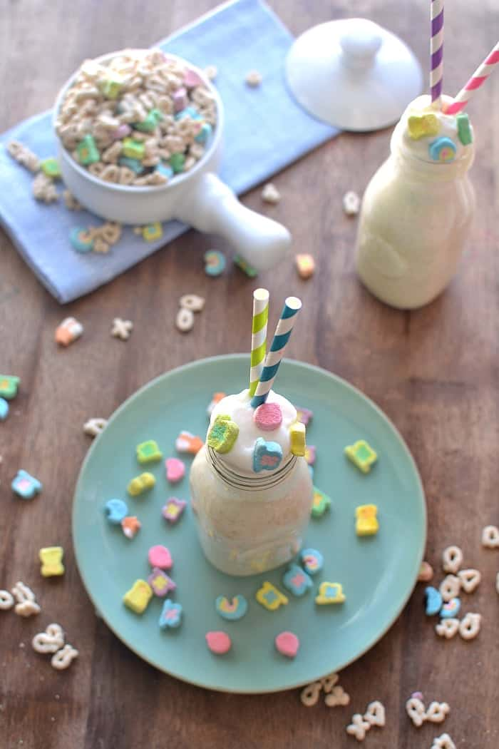 Lucky Charms Milkshake. Creamy vanilla ice cream blended with Lucky Charms and marshmallow fluff and topped with whipped cream and Lucky Charms marshmallows!
