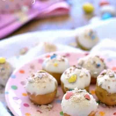 Easter Cookie Dough Buckeyes are made with peanut butter cookie dough and stuffed with malted milk balls and dipped in white chocolate.