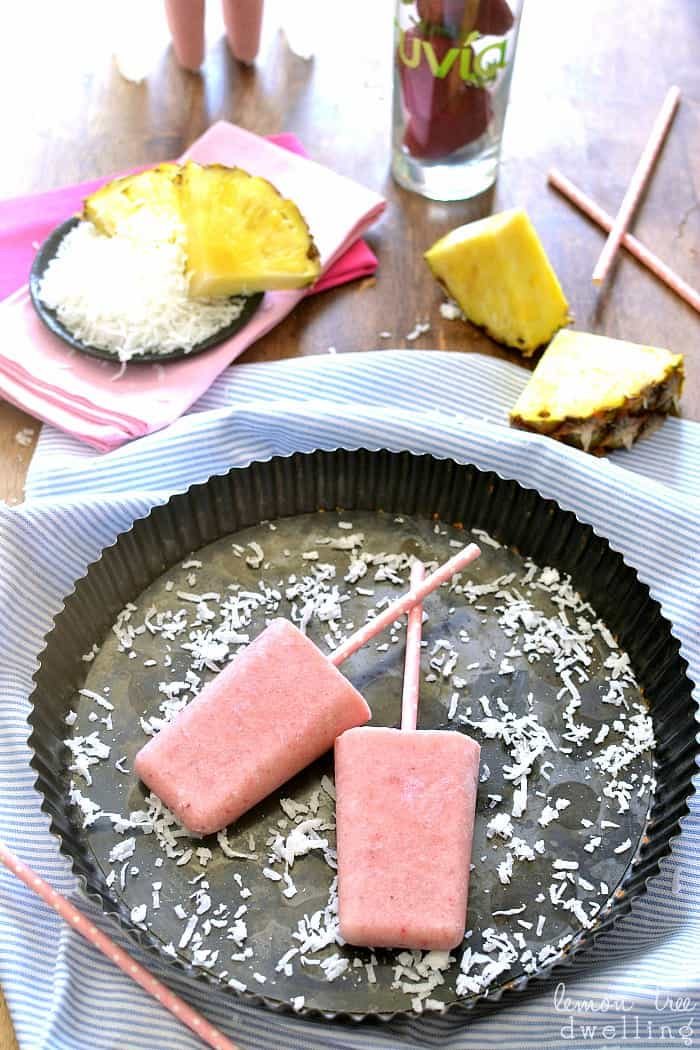 Strawberry Colada Popsicles made with coconut milk, fresh fruit, and Truvia!