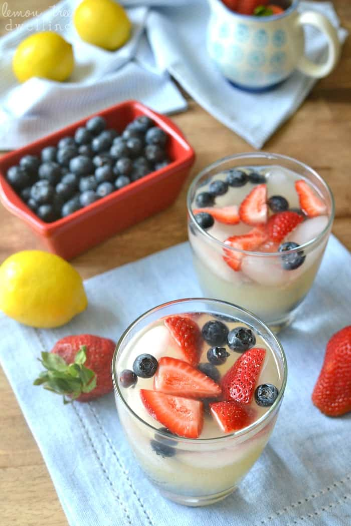 Lemon Margaritas made with organic pure lemon juice and garnished with fresh berries. The perfect drink for summer!