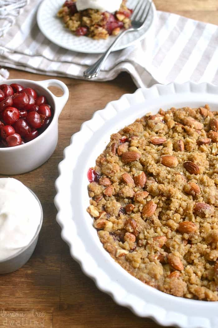 Homemade Cherry Crisp, packed with almonds and topped with a thick layer of crunchy brown sugar streusel. Serve it with homemade amaretto whipped cream for an extra special treat!