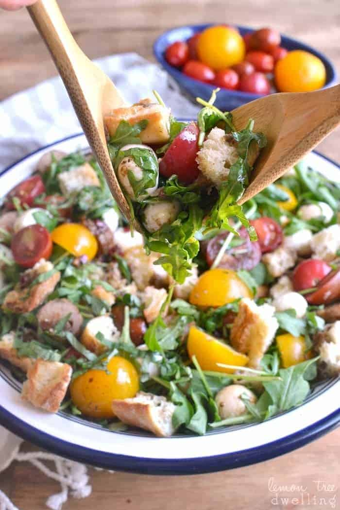 This Caprese Panzanella combines fresh arugula and crusty bread with multicolored tomatoes, fresh mozzarella, Italian sausage, and fresh basil. Drizzle it with homemade balsamic vinaigrette for a light, fresh, flavor-packed summer meal!