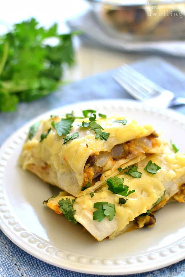 The BEST Sweet Potato Black Bean Burritos made with fresh sweet potatoes, black beans, cilantro, onions, and cheese. Make them ahead for a quick & easy weeknight meal!