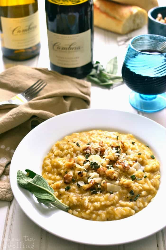 Butternut Squash Risotto is rich and creamy, flavored with allspice, walnuts, Parmesan, and chardonnay. It's the perfect fall risotto recipe, and a delicious addition to any holiday table!