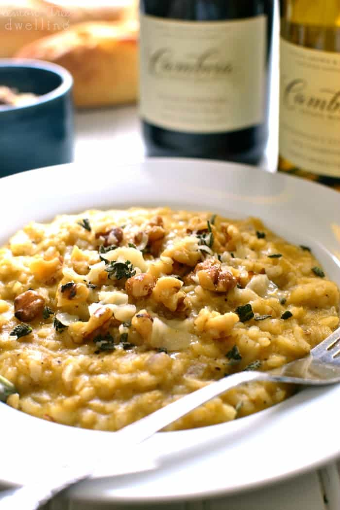 This Butternut Squash Risotto is rich and creamy, flavored with allspice, walnuts, parmesan, and chardonnay. It's the perfect fall risotto, and a delicious addition to any holiday table!