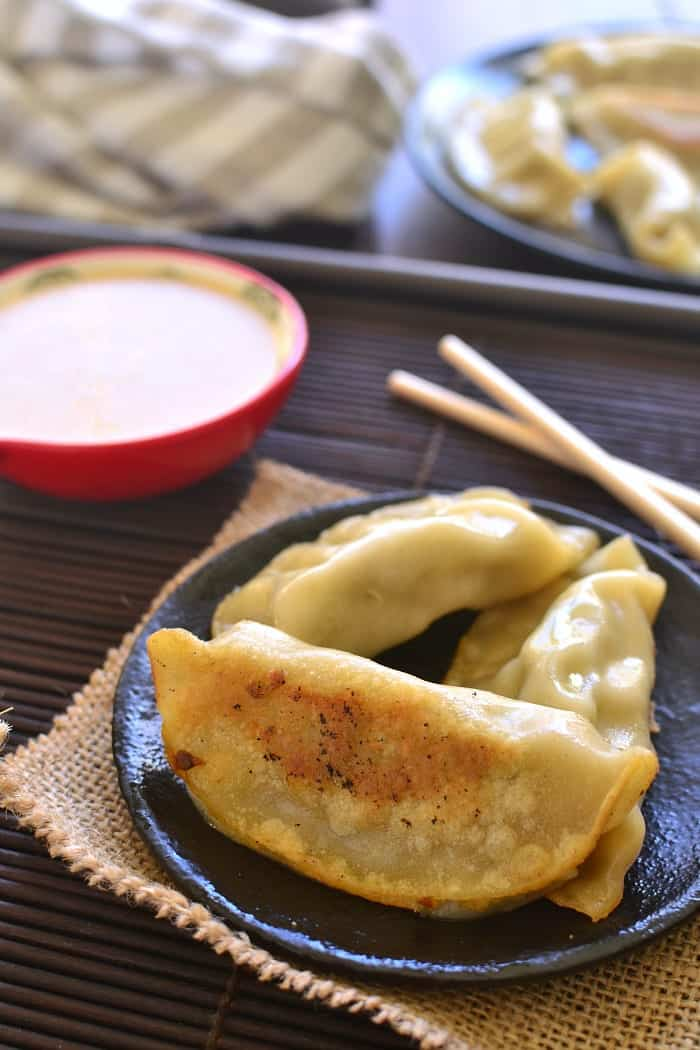 This Creamy Ginger Soy Dipping Sauce is sweetened with honey and perfect for dipping pot stickers, spring rolls, or your favorite Asian appetizers!