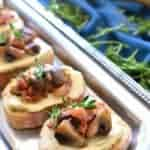Mushroom Bacon Swiss Crostini is packed with delicious flavor and so simple to make! The perfect holiday appetizer recipe