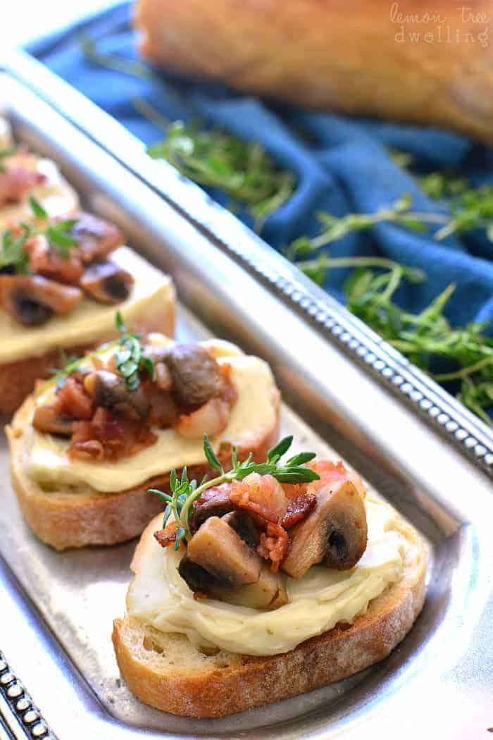 This Mushroom Bacon Swiss Crostini is packed with delicious flavor and so simple to make! The perfect holiday appetizer recipe - it's sure to please a crowd!