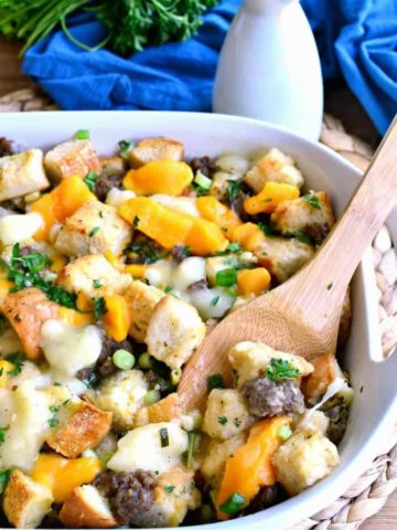 Poutine Stuffing is packed full of porksausage and cheese curds and topped with a delicious poutine gravy. It's such a fun twist on classic poutine -the perfect Thanksgiving side dish recipe!