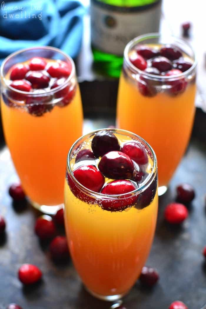 Cranberry Orange Mimosas are a deliciously sweet brunch cocktail and perfect for any celebration! This easy drink can be a beautiful accompaniment to any holiday table