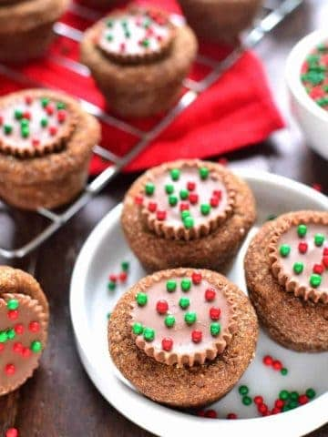 Peanut Butter Cup Stuffed Ginger Cookies are deliciously sweet with an unexpected twist! The perfect addition to your holiday cookie plate!