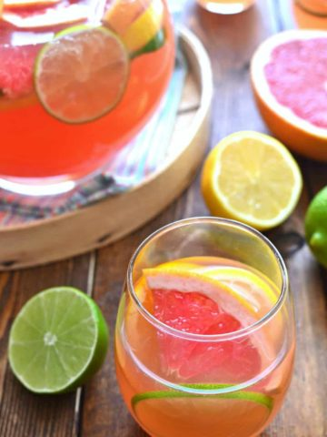 Delicious Citrus Sangria is made with just 4 simple ingredients and loaded with fresh citrus fruit. A perfectly refreshing cocktail any time of year!