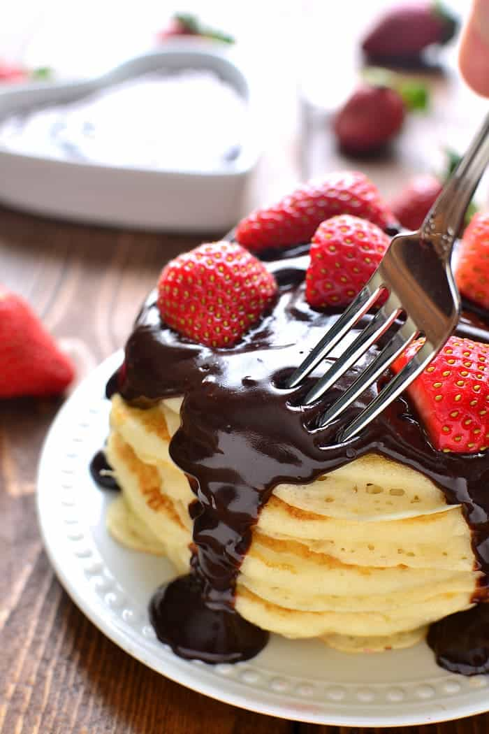 These Chocolate Covered Strawberry Pancakes are light and fluffy, topped with fresh strawberries and rich chocolate ganache. Perfect for Valentine's Day or any special occasion!