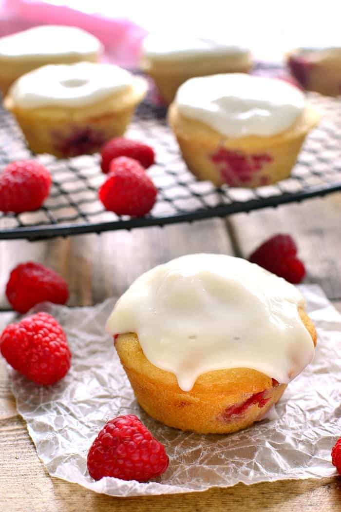 These Iced Raspberry Muffins are loaded with fresh raspberries and topped with a deliciously sweet cream cheese icing. The perfect way to start your day!