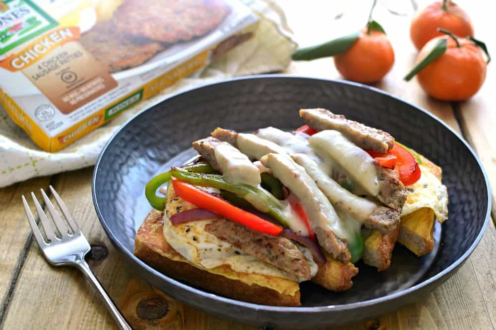 These Breakfast Cheesesteaks are everything you could want in a breakfast sandwich! They start with French toast and are topped with eggs, peppers, onions, cheese, and Jones Dairy Farm Chicken Sausage Patties. Perfect for breakfast, brunch, or brinner!