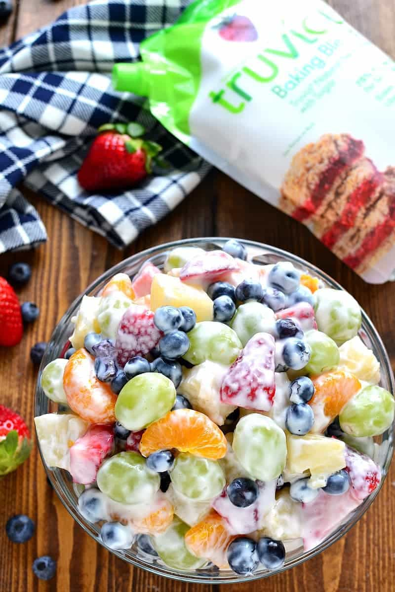 This Skinny Ambrosia Fruit Salad combines 5 types of fruit with a sweetened Greek yogurt sauce - the perfect {healthier} way to dress up your ordinary fruit salad!
