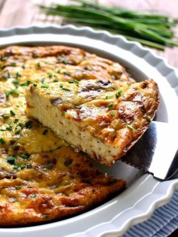 This Crustless Quiche Lorraine is a delicious twist on a classic recipe. This crustless quiche is loaded with bacon, eggs, Swiss cheese, and cream. Perfect for Easter brunch or any family gathering that will please all your guests.